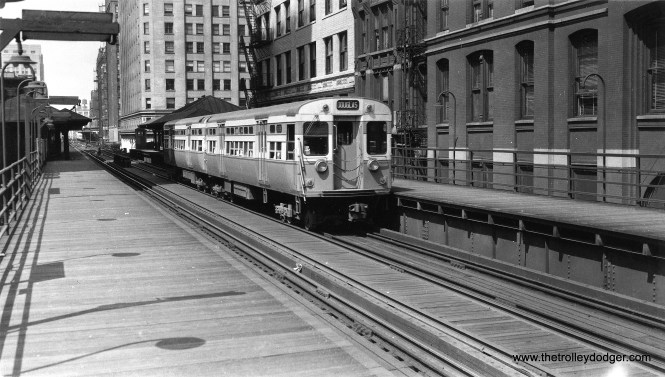"""This circa 1952 shot of CTA 6097-6098 was taken from the LaSalle and Van Buren platform, looking west towards the junction at Wells and Van Buren. In the distance, you can see the Franklin Street station, used by Metropolitan """"L"""" trains. It was not on the Loop itself. (George Trapp Collection)"""
