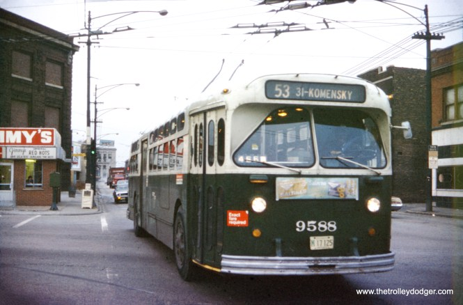 CTA trolley bus 9588 is southbound on Pulaski at Grand Avenue on March 12, 1973, not long before the end of electric bus service. Jimmy's Red Hots is at left. (William Shapotkin Collection)