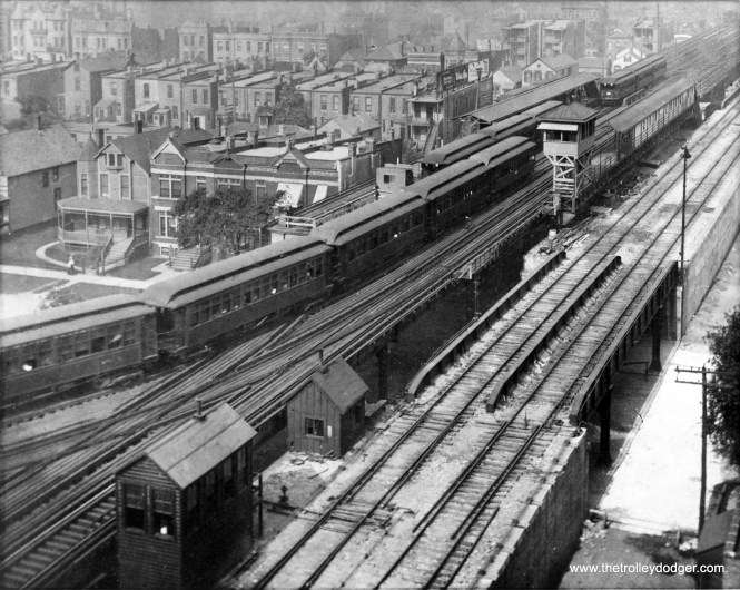 """This circa 1910 view of Indiana Junction on the South Side """"L"""" looks to the southwest. Once branch lines were opened here, going to Kenwood and the Stock Yards, this became a busy transfer point. The """"L"""" tracks here ran parallel to 40th Street and were adjacent to the Chicago Junction Railway's freight line, seen at right. A southbound Jackson Park Express train runs on the middle track, turning south, with its next stop at 43rd Street. (Chicago Transit Authority Historical Collection)"""