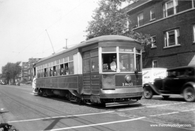 CSL 1801 is signed for Adams-Downtown in this circa 1940 photo. Part of Route 7 - Harrison Street went downtown via Adams Street. A nearby truck is delivering Ogden's Milk.