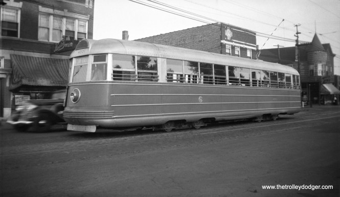 Chicago Surface Line experimental pre-PCC 4001 in 1935, running on Route 22 - Clark-Wentworth. 40001 was built in 1934 by Pullman-Standard and was retired in 1944. The body has survived and is now at the Illinois Railway Museum. Here, it still has the striped trolley pole.