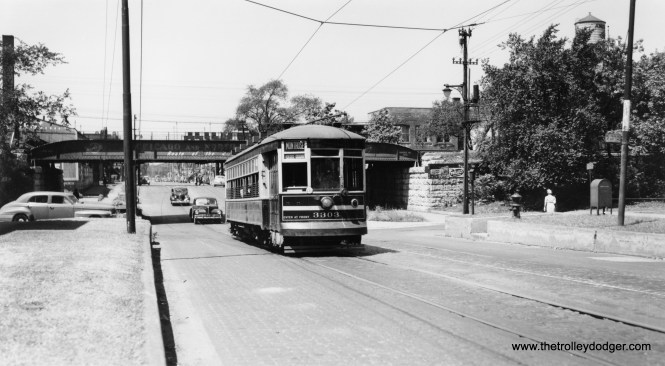 """CSL 3303 is eastbound on Montrose, having just crossed under the Chicago & North Western and the Ravenswood """"L""""."""