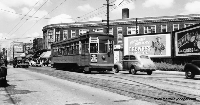 """CSL 3010 is signed for Elston-Downtown. Bill Wasik adds, """"Shapotkin 294 shows the 4700 block of Elston Ave. looking north toward Lawrence Ave. The photo likely was taken in 1946-47. The large three-story commercial building seen in the distance behind the Drewrys billboard was part of the Bankers Life complex. Demolished in the 1990s, it was replaced by an apartment complex for seniors. Most of the other buildings in this scene are still standing."""""""