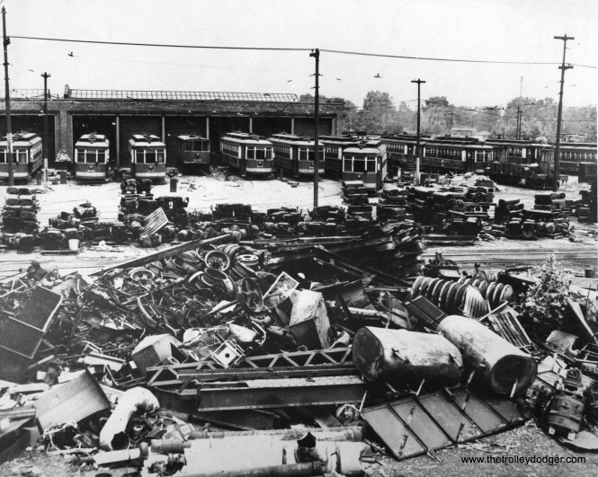 """Andre Kritsopans: """"Looking west towards east end of """"east house"""" at 77th, basically where Wentworth south of 77th would be. 77th until 1970s had two separate buildings, with an open area between them, until the open area was roofed over. The pile of junk in front is 77th scrap pile, looks like mostly boilers and other building parts."""""""