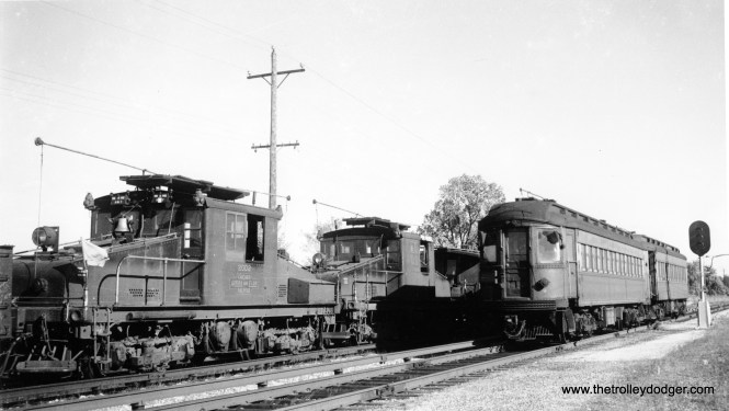 CA&E electric loco 2002 is at left. I can't make out the numbers on the steel cars at left.