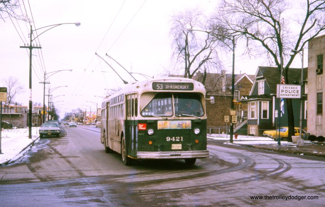 """CTA trolley bus 9421 on February 12, 1973. Andre Kristopans adds, """"Trolley bus 9421 SB on Pulaski at Sunnyside (4500 N). Old police station, now community center, on right."""" William Shapotkin Collection)"""
