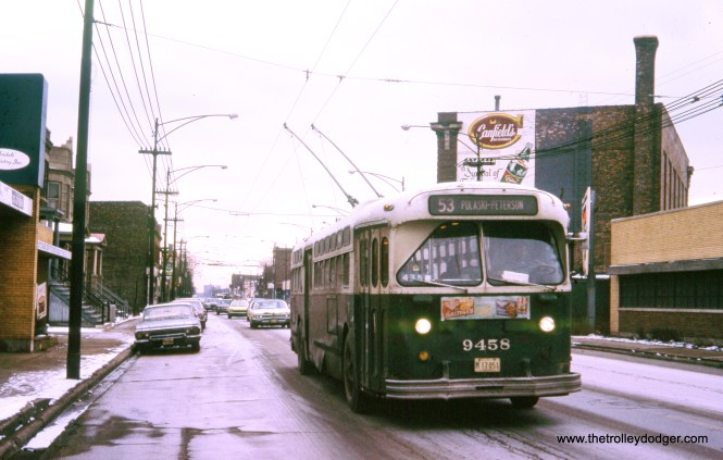 """CTA trolley bus 9458 on February 10, 1973. (Michael N. Charnota Photo, William Shapotkin Collection) Bill Jas: """"The pic of the Pulaski trolley bus is just North of Grand. You can see the old streetcar power house on the right. The same building that later collapsed onto Jimmy's Hot Dog Stand."""""""