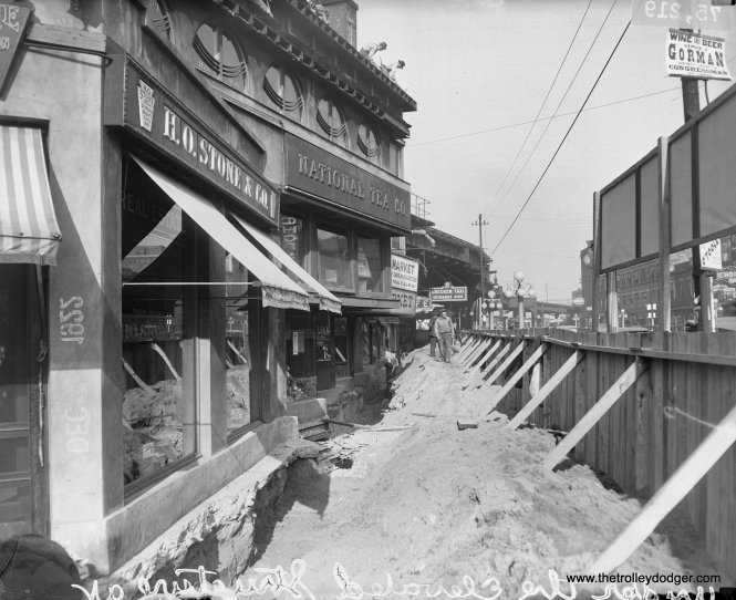 """The beginnings of demolition of the Stohr Arcade building at Broadway and Wilson in December 1922. This Frank Lloyd Wright-designed triangular structure, partially hidden underneath the Northwestern """"L"""". barely lasted a decade and was replaced by Arthur U. Gerber's Uptown Union Station the following year. (Chicago Daily News Collection, DN-0075219, Chicago History Museum)"""
