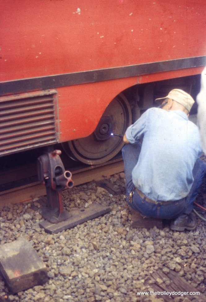 A Pittsburgh Railways employee works on a PCC wheel in August 1957.