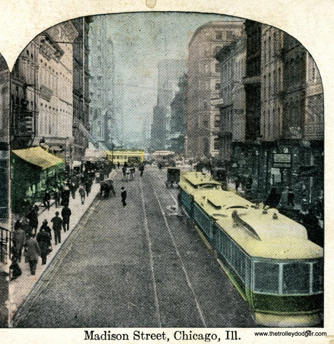 A three-car train of cable cars on Madison Street in the 1890s. This is a colorized photo.
