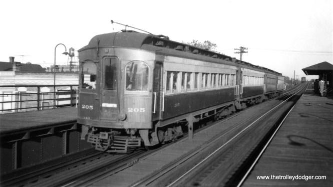 "Chicago Aurora & Elgin car 205 heads up a westbound four-car train at Cicero Avenue on the Garfield Park ""L""."