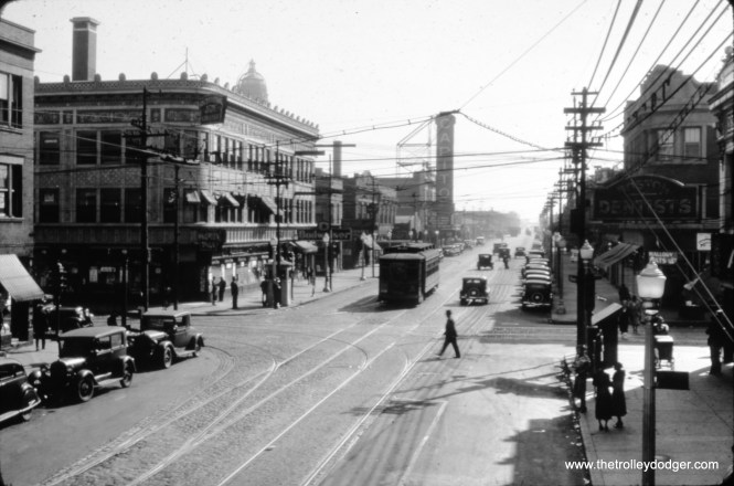 """CSL 5222 on Halsted at 79th Street, apparently in the late 1920s. The Capitol Theater was located at 7941 S. Halsted and opened in 1925. The view looks south. M.E. notes: """"In this photo you see tracks switching between Halsted and 79th St. These switches took Halsted cars east on 79th St. to Vincennes, then north to 77th St. to the big CSL barn. Those tracks could also have led to Emerald Ave. (a half block east of Halsted), where the Halsted cars turned south, then west into the terminal at roughly 79th Place between Emerald and Halsted. From the picture, I can't determine whether that terminal existed in the 1920s. Halsted cars could have also used the barn farther south at 88th and Vincennes, which had been the barn for the interurban line that ran from Kankakee to the L at 63rd Place and Halsted."""" """"I don't know when the barn at 103rd and Vincennes (also on the Halsted route) opened, but even had it existed in the 1920s, there would not have been a track connection between the Halsted cars running on a private right-of-way east of Vincennes, and the barn on the southwest corner of 103rd and Vincennes. I say this with certainty because, at the intersection of 103rd St., Vincennes Ave. and Beverly Blvd. (which came in from the northwest), there was also the freight line of the Pennsylvania Railroad that ran alongside Beverly Blvd. and crossed both the CSL Vincennes line and the Rock Island main line. So there would not have been any room to run streetcar trackage to the barn! Plus, I believe the 103rd St. barn was strictly a bus barn. But the junction of 103rd and Vincennes, the center of the neighborhood called Washington Heights, would have been a great railfanning location, with Rock Island mainline and commuter trains, CSL Vincennes streetcars, and the Pennsy freights."""""""