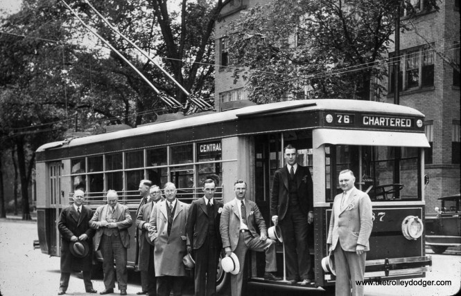 """CSL trolley bus 87 is on Central Avenue near Lake Street on June 7, 1930. These are probably CSL officials, since trolley bus service on Route 85 - Central began the next day, replacing a Chicago Motor Coach route. CSL had begun trolley bus service on Diversey Avenue on April 17, 1930, which explains why this chartered bus was signed for Route 76. Diversey lost its trolley buses in 1955. CSL chose trolley buses for some northwest side routes as they were in competition with the Chicago Motor Coach company to extend service there. It was quicker (and cheaper) for CSL to institute service with electric buses, with the intention (never realized) to convert them to streetcar lines once ridership justified it. This was part of what CSL called """"balanced"""" transit."""