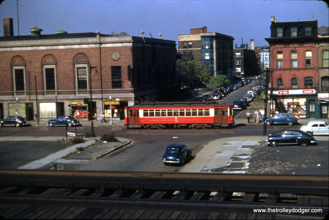 """This duplicate slide did not come with any information, but I am wondering if this was taken from the old Met """"L"""" looking to the north, which would mean the streetcar is on Van Buren. The Van Buren line was converted to bus in 1951 and the Garfield Park """"L"""" was re-routed via temporary ground level tracks on Van Buren starting in 1953. Since the buildings around the """"L"""" have been cleared away, that is further evidence that this is the Congress Expressway construction area. Michael Franklin has now identified this as Van Buren and Marshfield."""