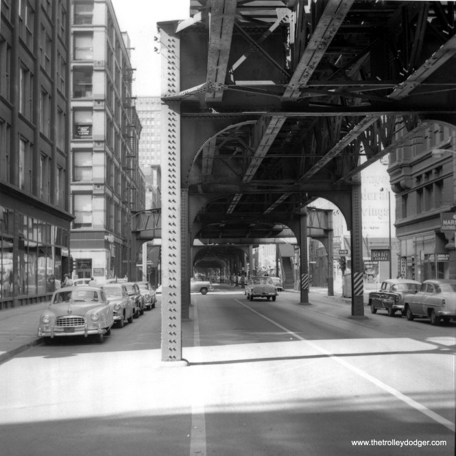 """The location of this 1950s Loop photo was a mystery. But Graham Garfield writes, """"It's Wells Street looking north at Monroe St. The 200 on the building in the background isn't 200N, it's 200W. Everything in this view is gone now, except the """"L"""" and the building on the near left (the SW corner of Wells/Monroe)."""""""