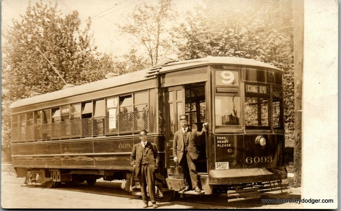 """For a minute, I thought this might be Chicago, but apparently not. There was a streetcar #6093 in Chicago, but not until 1914 and the beginnings of the CSL era. That's not a CSL logo on the side of the car. And Route 9 here was Ashland, not something going to Exchange Depot, whatever that was. It might possibly be Philadelphia, as they had cars like these in a 6000-series (later converted to Peter Witts with the addition of a center door), and they were an early adopter of numbered routes. But there is also a strange logo on the side of the car that I do not recognize. Frank Hicks: """"This is International Railway Company in Buffalo. It's part of a series of 200 Nearside cars built for them by Kuhlman in 1912, a follow-on to their original order for Nearside cars from Brill in 1911."""""""