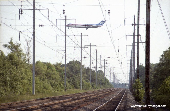 Texas International DC-9 crossing Amtrak on approach to BWI airport
