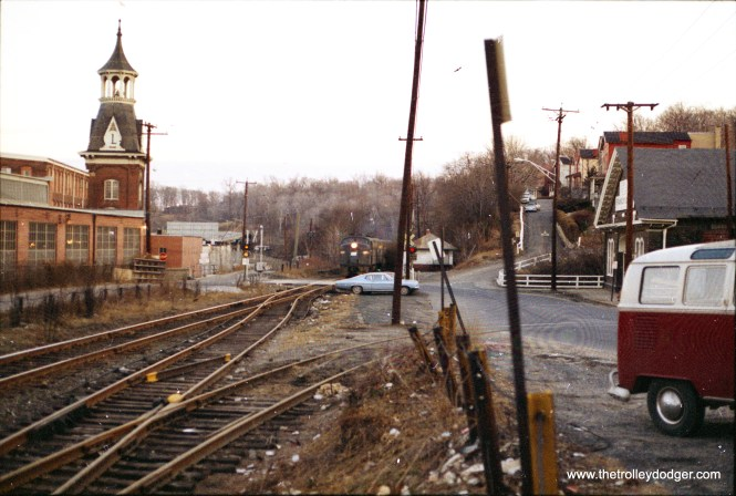 Northern Central branch of Conrail (ex-Pennsy) passing Woodberry Station enroute to Harrisburg. This is now Baltimore's light rail line, and there is still a Woodberry station, although the handsome old one is no longer with us.