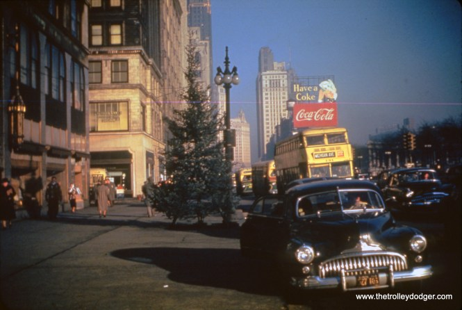 The view looking north along Michigan Avenue at Madison Street on December 12, 1949, shows no less than four Chicago Motor Coach buses, including a double-decker. The CTA purchased the CMC assets on October 1, 1952. (William C. Hoffman Photo, William Shapotkin Collection)