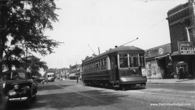 CSL 1682 is at Lake and Austin, west end of Route 16, with a West Towns streetcar across the border in suburban Oak Park. The Park Theater, at right, closed around 1952. (William Shapotkin Collection)