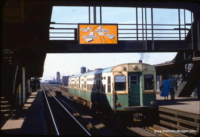 """This slide, taken on Sunday, March 6, 1955, gives a good view of the direction sign on the transfer bridge at 40th and Indiana station. Our resident South Side expert M. E. adds, """"Two-car trains were rare on the north/south main line. The destination sign explains why just two cars: It is an """"all-stop"""" sign reading """"Howard Street"""". Most days of the week, main line service was either """"A"""" or """"B"""". The only time the CTA ran just two cars on the main line as all-stop trains was on Sunday mornings."""" (William C. Hoffman Photo)"""