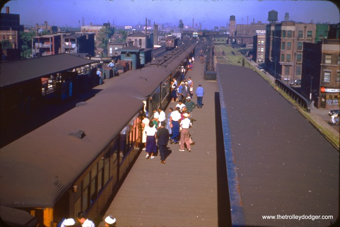 The view west from the overhead transfer bridge at 40th and Indiana on July 7, 1953, looking west. We see a northbound train of 4000s, an approaching southbound train of 6000s, a Stock Yards shuttle train, and some additional Stock Yards cars being stored on the former express track, unused since 1949. (William C. Hoffman Photo)
