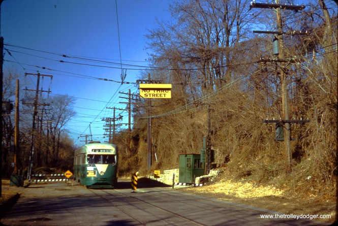 DC Transit 1553 at the Route 20 Plow Pit on February 7, 1959. This was a spot where overhead wire ended (by law) and streetcars changed over to collecting electricity through an underground conduit. (Clark Frazier Photo)