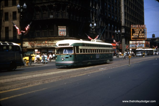 """CTA PCC 4371, built by Pullman, is on State Street heading south from Randolph, with the old State-Lake Theater in the background. The film """"Lovely To Look At"""" was released on July 4, 1952, which is probably around when this picture was taken."""