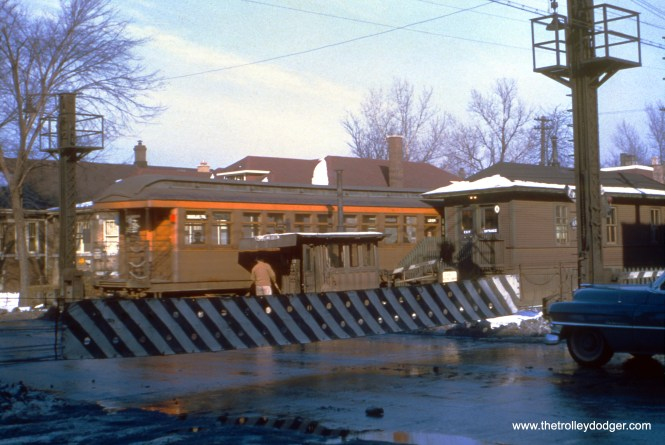 """In December 1950, CTA open platform, railroad-roofed car 2327 is westbound at Austin Boulevard on the Douglas Park """"L"""". Here, the barrier is down. (Truman Hefner Photo)"""