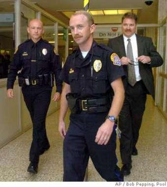 Officer Derrick Letsinger in the middle
