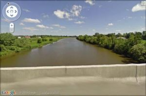 Image of the view from the bridge at the location of the Nation River Lady's remains .