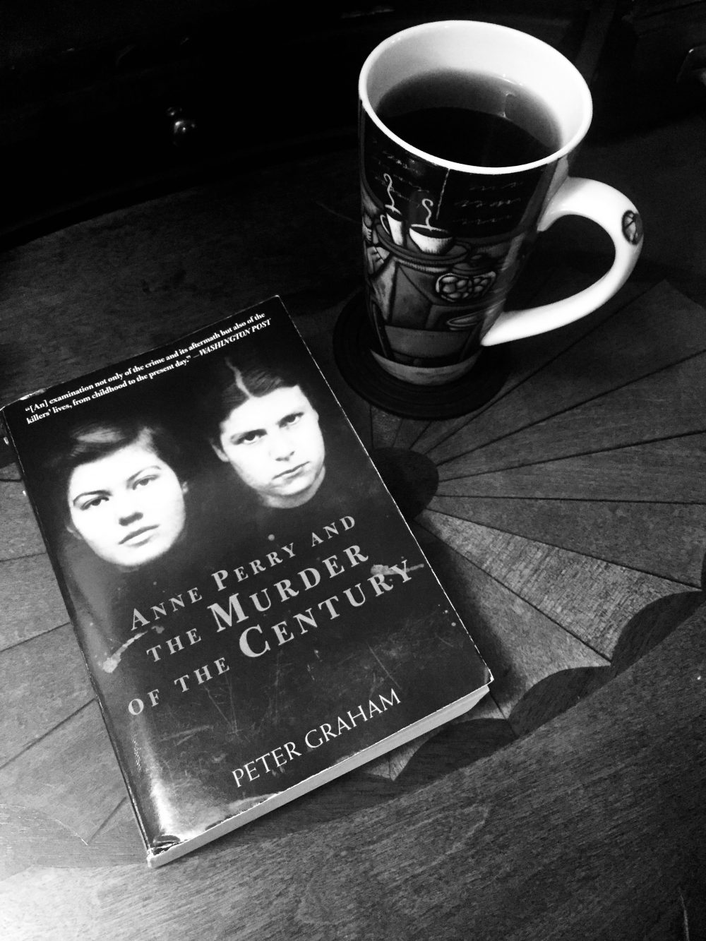 Image of the true crime book Anne Perry and the Murder of the Century and a cup of steaming chocolate mint tea