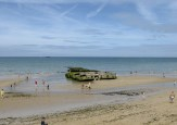 Remnants of the 'Mulberry' harbour at Arromanches - The Best of France: A Two Week Itinerary - The Trusted Traveller