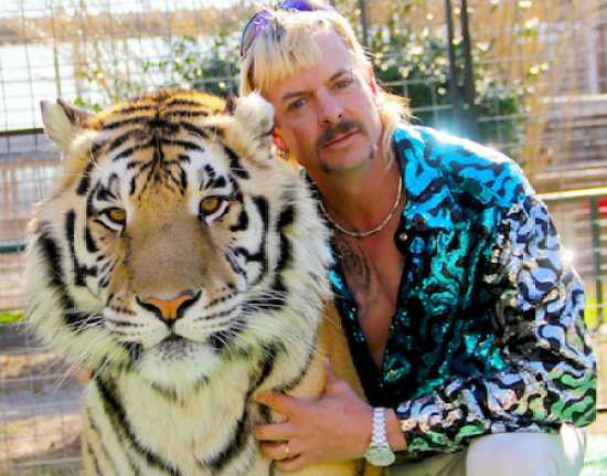 Joe Exotic's watch is almost as bling as his furry friend