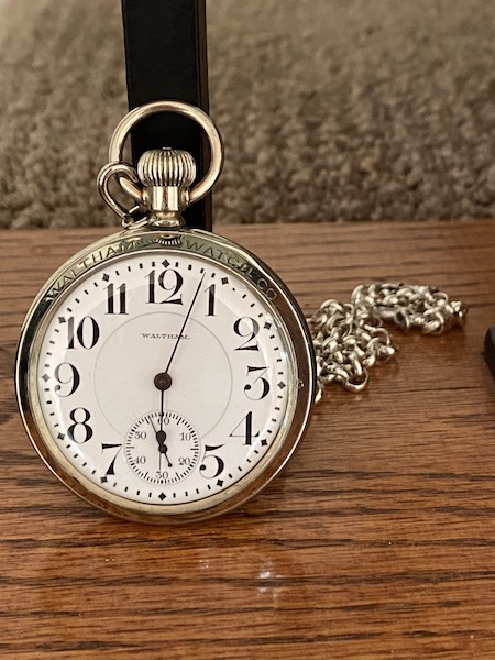 Waltham pocket watch on stairs