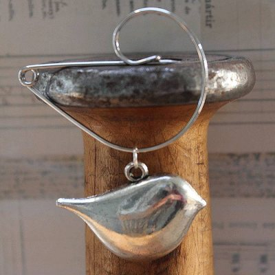 Contemporary Bird on a Swirl Pin