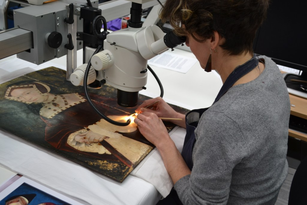 Conservator at work restoring the NPG painting of Jane Seymour