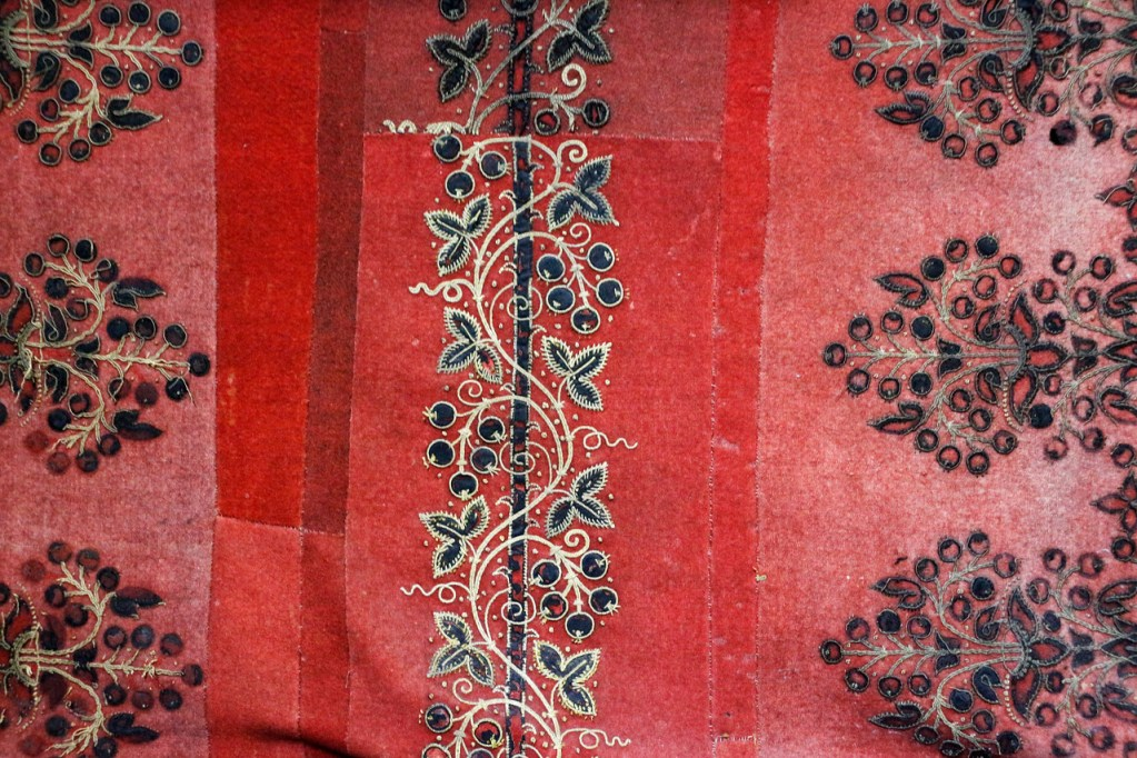 Rich red 500-year-old wall hanging with fine embroidery in black and gold silk