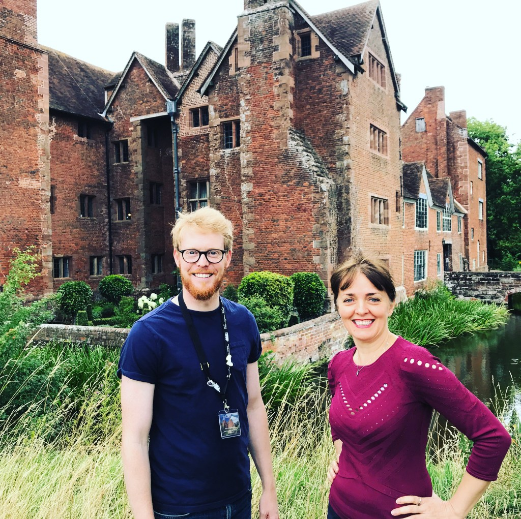 Two people outside Harvington Hall