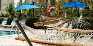 Hammocks and a path to the beach at Comfort Suites Seven Mile Beach in Grand Cayman.