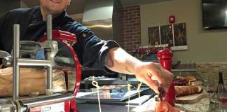 Chef serving proscuitto.