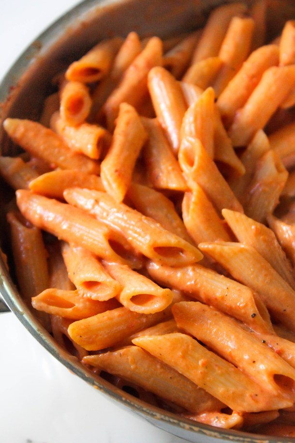 Penne pasta tossed in a creamy pink orange sauce.