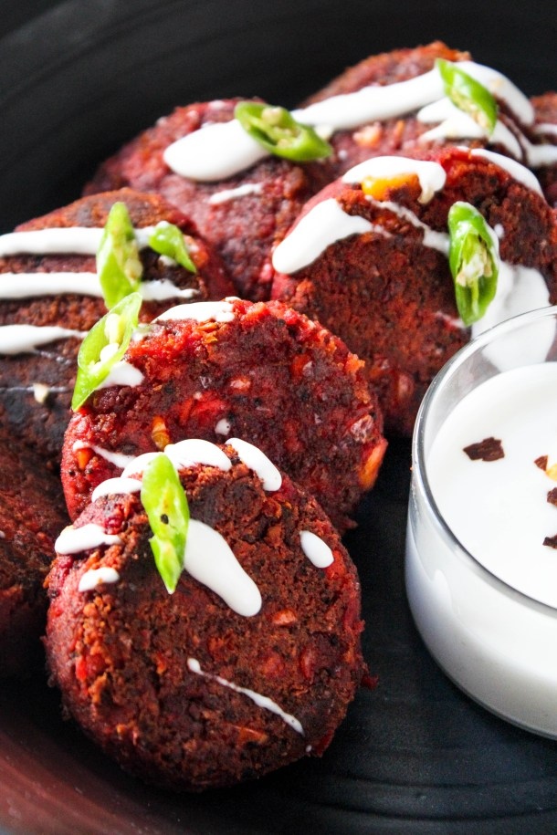 Soft Gluten Free Beetroot, Corn, Carrots and Chickpea Kebabs in a black dish served with a white dip