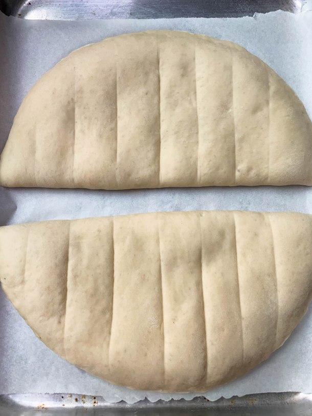 garlic bread dough on a baking sheet