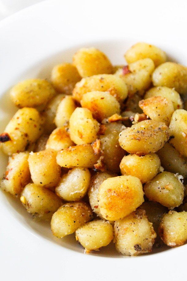 Pan Fried Gnocchi in a white plate.