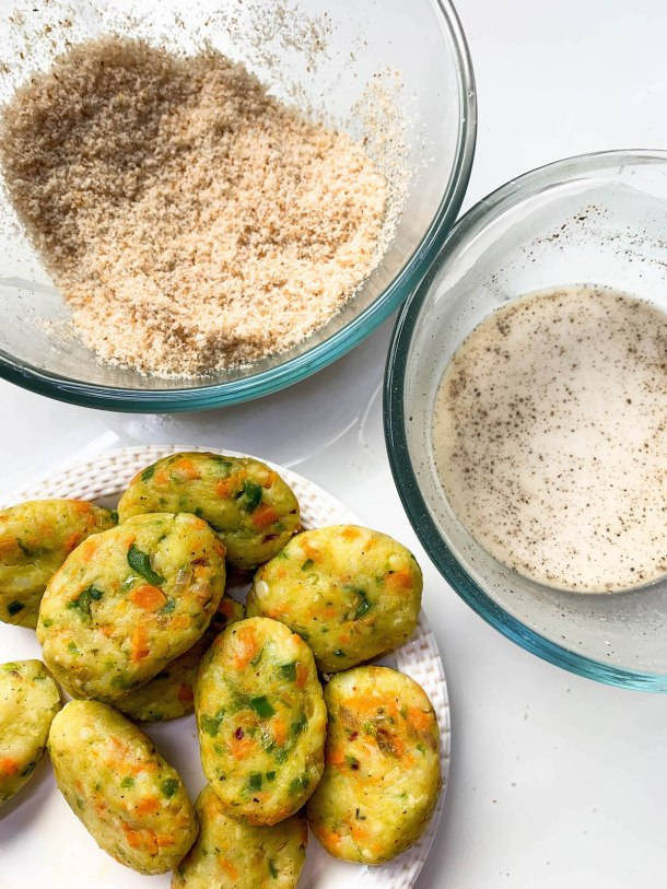 Oval Shaped Potato Nuggets, Bread Crumbs and Corn Flour Slurry