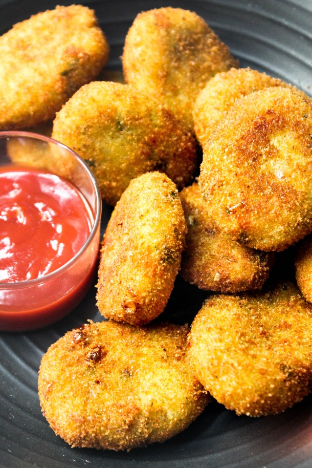 Mix vegetable potato nuggets served in a black plate.