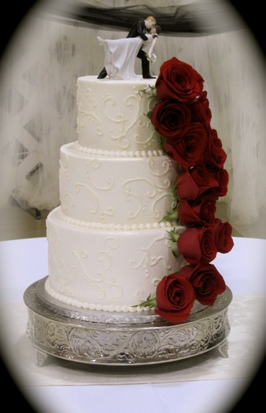 red   The Twisted Sifter White Wedding Cake with Fresh Red Roses