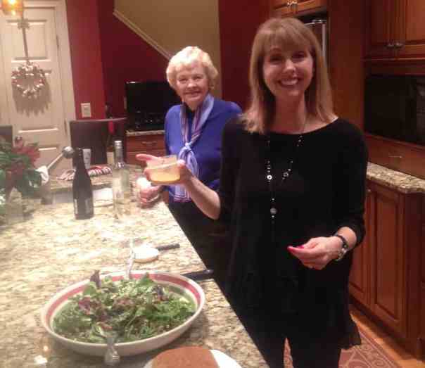 Laura and her mom cooking Christmas Eve