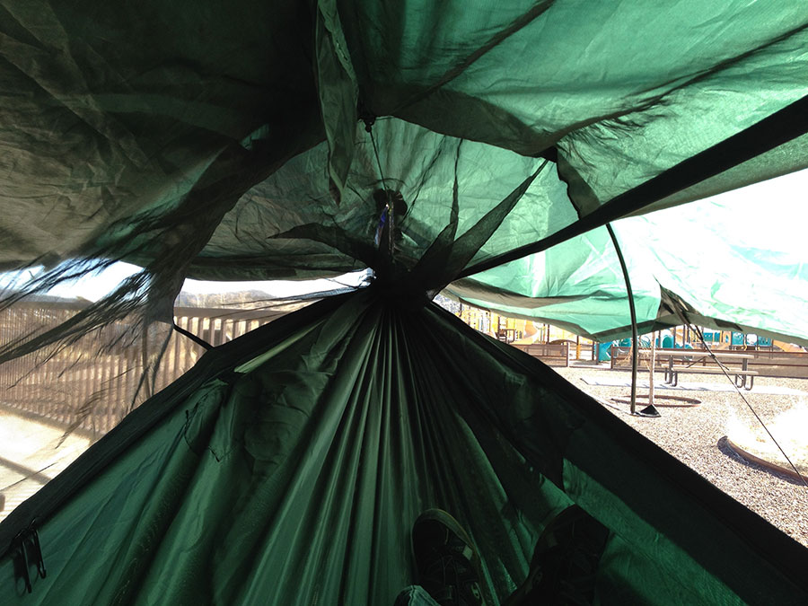 Showing the foot end with the tent pole. Notice the increased visibility as the tarp is pulled out higher from the hammock.